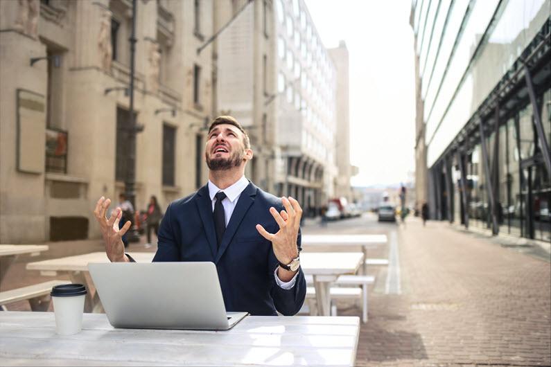 Stressed man at desk needs a VA